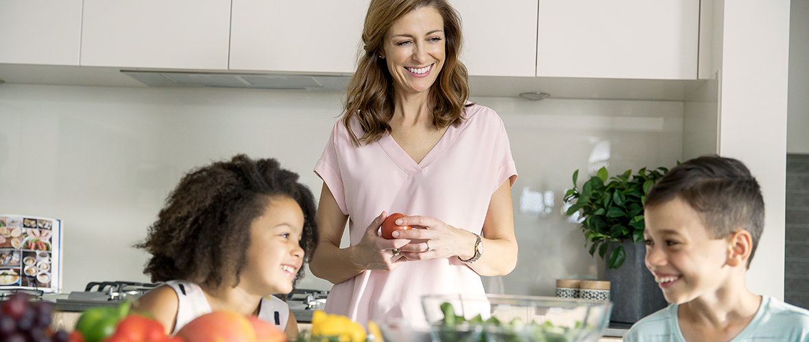 Family at Springfield Rise, smiling in the kitchen