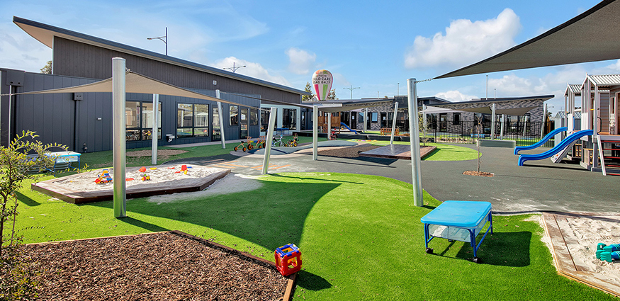 Outdoor play area with sun protection sails